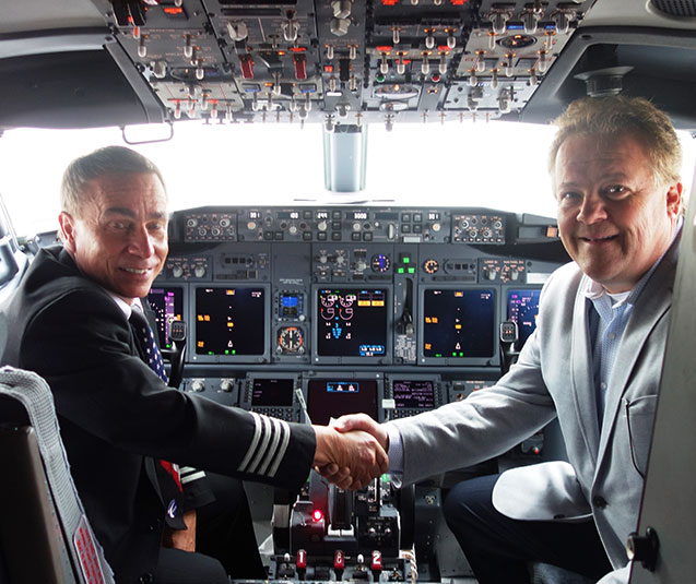 Sun Country Capt. Brian Roseen and the pilots' Master Executive Council chairman Marty Davis - ALPA